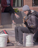 "A busker touts his ""wares"" during a Saturday morning farmers' market."