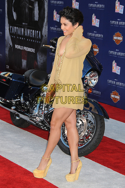 "Vanessa Hudgens.Premiere of ""Captain America: The First Avenger"" held at The El Capitan Theatre in Hollywood, California, USA..July 19th, 2011.full length yellow gold beige sheer short cropped hair sequins sequined tunic dress brown clutch bag wood wooden print ankle strap platform shoes side profile arm.CAP/ADM/BP.©Byron Purvis/AdMedia/Capital Pictures."