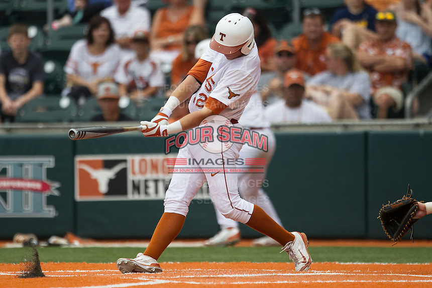 Texas Longhorns first baseman Kacy Clemens #42 swings the bat during the NCAA baseball game against the Oklahoma State Cowboys on April 26, 2014 at UFCU Disch–Falk Field in Austin, Texas. The Cowboys defeated the Longhorns 2-1. (Andrew Woolley/Four Seam Images)