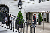 United States President Donald J. Trump speaks to reporters about the pending confirmation vote for U.S. Supreme Court nominee Brett Kavanaugh as he departs for Topeka, Kansas, from the White House in Washington, D.C., U.S. on Saturday, Oct. 6, 2018. <br /> Credit: Joshua Roberts / Pool via CNP