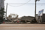 Mar. 13, 2011 - Kita-Ibaraki, Japan - A view of a building completely destroyed to the ground two days after the 8.9 magnitude earthquake struck followed by a tsunami that hit the north-eastern region. The death toll is currently unknown with casualties that may run well into the thousands.