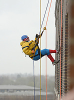 NWA Democrat-Gazette/BEN GOFF @NWABENGOFF<br /> Ryan Love, a Sunshine School and Development Center adult client from Rogers, rappels wearing a Spider-Man costume Saturday, March 11, 2017, during the Sunshine School &amp; Development Center's rappelling fundraiser with Over The Edge at the 8W Center in Bentonville. The school began a campaign in January, with participants who reached their fundraising goal able to participate in rappelling from the roof of the 6-story building. Over the Edge is a company which specializes in producing events for non profits using equipment and techniques used in commercial rope-access work such as sign installation and window washing. The event had raised more than $57,000 for the school, with more donations still coming in Saturday morning. Located in Rogers, the Sunshine School &amp; Development Center serves children and adults with developmental dissabilities, including a preschool.
