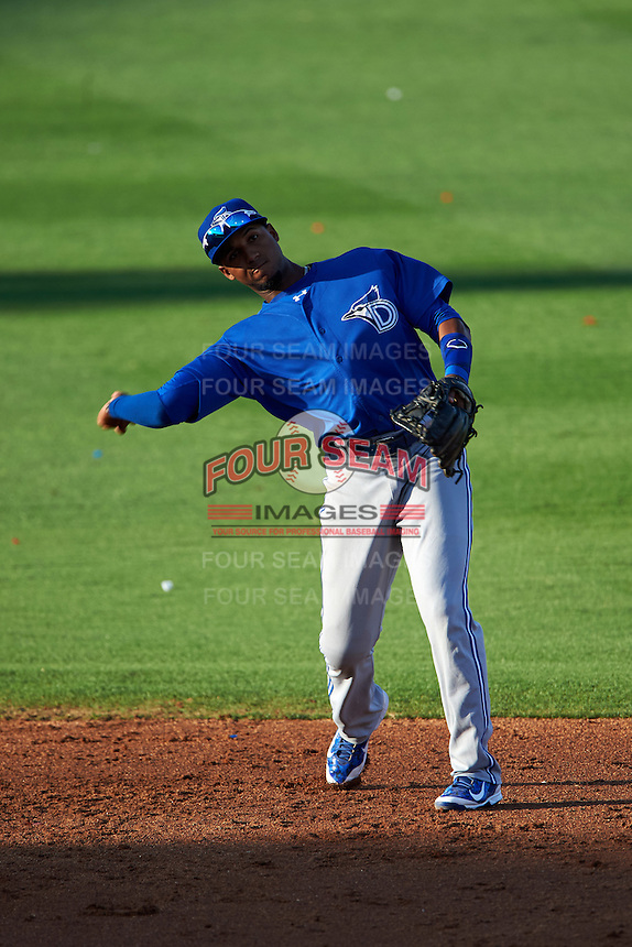 Dunedin Blue Jays shortstop Richard Urena (5) warmup throw to first during a game against the Clearwater Threshers on April 8, 2016 at Bright House Field in Clearwater, Florida.  Dunedin defeated Clearwater 8-3.  (Mike Janes/Four Seam Images)