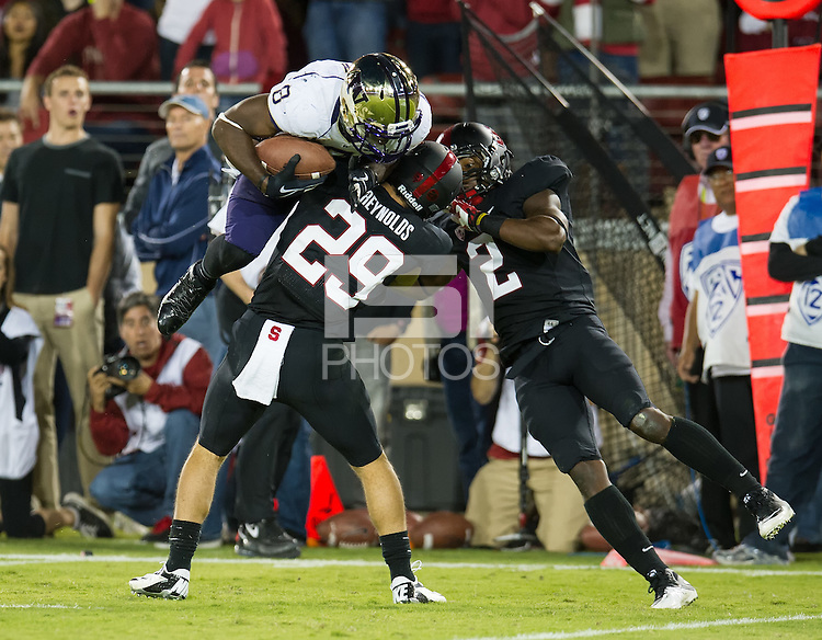 STANFORD, CA - October 5, 2013:  Stanford Cardinal free safety Ed Reynolds (29) makes a tackle during the Stanford Cardinal vs the Washington Huskies at Stanford Stadium in Stanford, CA. Final score Stanford Cardinal 31, Washington Huskies  28.