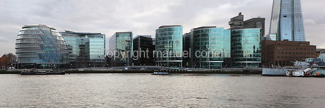 Panorama of riverside buildings, London, UK, with Shard London Bridge, also known as London Bridge Tower, 2012, Renzo Piano (right) and City Hall, Foster & Partners, 2002, (left) Southbank, River Thames, London. Nicknamed the London Egg, the 45m high City Hall is the headquarters of the Greater London Authority. Its glass and steel structure incorporates environmentally friendly features such as solar panels. Picture by Manuel Cohen