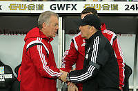 L-R Swansea manager Alan Curtis grets West Bromwich Albion manager Tony Pulis  during the Barclays Premier League match between Swansea City and West Bromwich Albion played at the Liberty Stadium, Swansea on December 26 2015