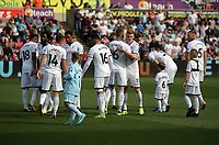 Swansea players embrace before kick off during the Premier League match between Swansea City and Watford at The Liberty Stadium, Swansea, Wales, UK. Saturday 23 September 2017