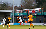 Barnet 2 Morecambe 0, 16/12/2017. The Hive, League Two. Adam McGurk of Morecambe wins a header as a tube train passes. Photo by Paul Thompson.