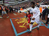 Sunday 07 December 2014<br /> Pictured: Wilfried Bony of Swansea with girl mascot<br /> Re: Premier League West Ham United v Swansea City FC at Boleyn Ground, London, UK.
