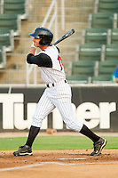 John Spatola #18 of the Kannapolis Intimidators follows through on his swing against the Hagerstown Suns at Fieldcrest Cannon Stadium August 10, 2010, in Kannapolis, North Carolina.  Photo by Brian Westerholt / Four Seam Images