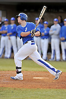 First baseman Mason Berne (20) of the Spartanburg Methodist College Pioneers hits a home run in a junior college game against Surry Community College on January 31, 2016, at Mooneyham Field in Spartanburg, South Carolina. (Tom Priddy/Four Seam Images)