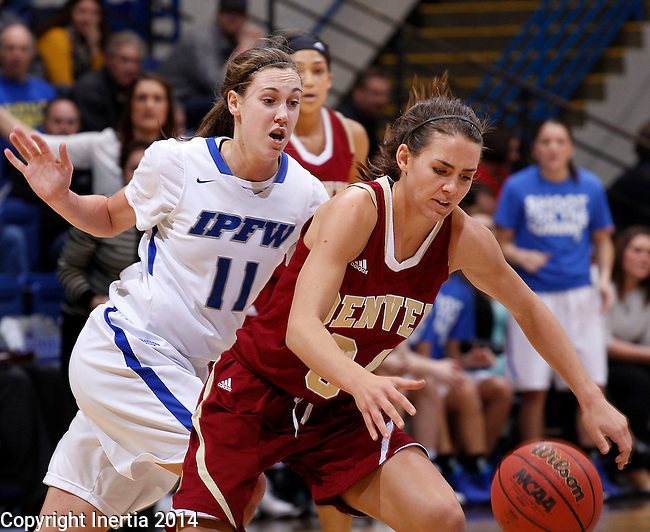 SIOUX FALLS, SD - MARCH 9:  Amanda Hyde #11 of IPFW puts pressure on Rebecca Bruner #34 of Denver during their quarterfinal game at the 2014 Summit League Basketball Championships Sunday at the Sioux Falls Arena.  (Photo by Dick CarlsonInertia)