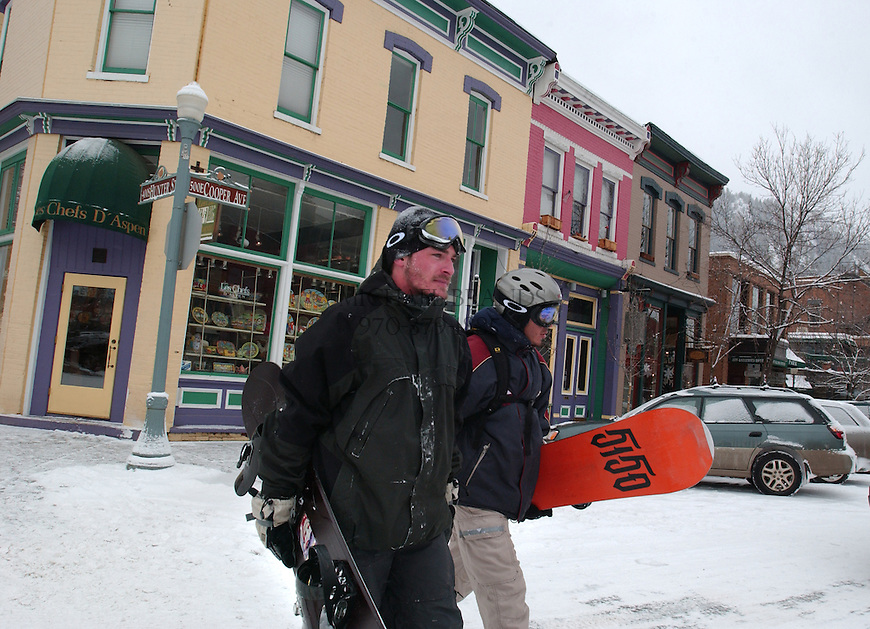 Snowboarders return from a day on the slopes at Aspen Mountain. Aspen, CO. © Michael Brands. 970-379-1885.