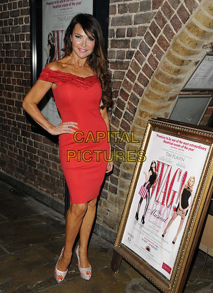Lizzie Cundy<br /> 'Wag! The Musical' VIP Night at the Charing Cross Theatre, London, England.<br /> August 7th 2013<br /> full length red dress off the shoulder hand on hip lace <br /> CAP/CAN<br /> &copy;Can Nguyen/Capital Pictures