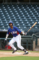 Ti'Quan Forbes #19 of the AZL Rangers bats against the AZL Cubs at Surprise Stadium on July 6, 2014 in Surprise, Arizona. (Larry Goren/Four Seam Images)