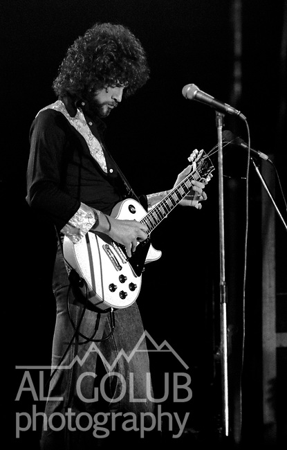 Lindsey Buckingham<br /> Modesto, California&mdash;Some time in early 1976, Fleetwood Mac Kingfish and an unknown at this time other groups played For Jerry Schweitzer at the Olympic Gold Ice Arena. Fleetwood Mac performers were Mick Fleetwood (drums) Stevie Nicks (vocals), John McVie (bass)  Christine McVie (keyboard) and Lindsey Buckingham (lead Guitar)Photo by Al Golub/Golub Photography