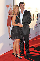 "Cheryl Hines & John Michael Higgins at the premiere of their new movie ""The Ugly Truth"" at the Cinerama Dome, Hollywood..July 16, 2009  Los Angeles, CA.Picture: Paul Smith / Featureflash"