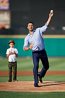 Former big leaguer Garrett Jones throws out the first pitch prior to a game between the Rochester Red Wings and the Lehigh Valley IronPigs on June 30, 2018 at Frontier Field in Rochester, New York. His son stands on the mound behind him waiting to throw out his own first pitch.  Lehigh Valley defeated Rochester 6-2.  (Mike Janes/Four Seam Images)