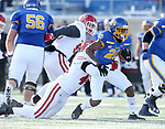 BROOKINGS, SD - NOVEMBER 17: Pierre Strong, Jr. #20 from South Dakota State University is brought down from behind by Darin Greenfield #44 from the University of South Dakota during their game Saturday afternoon at Dana J. Dykhouse Stadium in Brookings, SD. (Photo by Dave Eggen/Inertia)