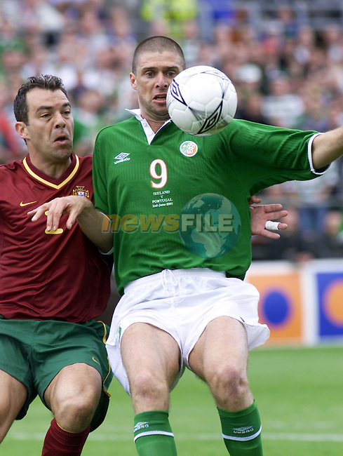 Republic of Ireland's Niall Quinn and Portugal's Jorge Almeida in action in thier World Cup  2002 Qualifer match at Landsdowne Road, Dublin..Picture: Paul Mohan, Newsfile/AFP