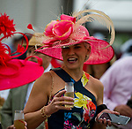 LOUISVILLE, KY - MAY 05: A woman enjoys a drink on Kentucky Derby Day at Churchill Downs on May 5, 2018 in Louisville, Kentucky. (Photo by Scott Serio/Eclipse Sportswire/Getty Images)