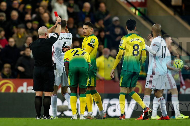 Chris Basham of Sheffield United is shown a red card but it is later overturned by VAR during the Premier League match at Carrow Road, Norwich. Picture date: 8th December 2019. Picture credit should read: James Wilson/Sportimage