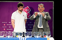 30 MAY 2012 - LONDON, GBR - Leon Kalin (right) from the IHF Competitions Commission is watched by Great Britain player John Pearce as he announces the group for current Olympic women's champions Norway, during the London 2012 Olympic Games Handball Draw at the National Sports Centre in Crystal Palace, Great Britain (PHOTO (C) 2012 NIGEL FARROW)