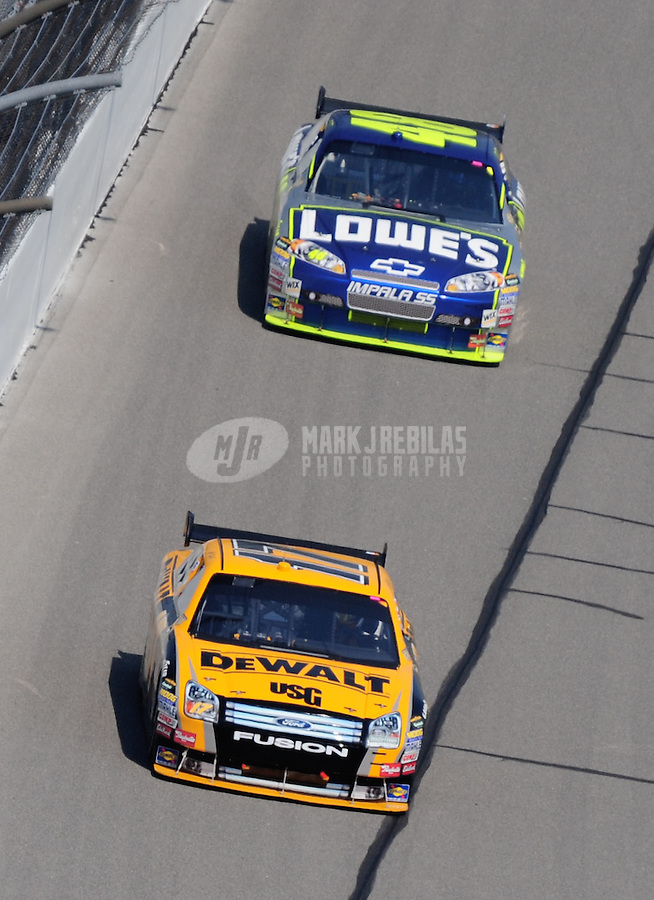Sept. 28, 2008; Kansas City, KS, USA; Nascar Sprint Cup Series driver Matt Kenseth (17) leads Jimmie Johnson (48) during the Camping World RV 400 at Kansas Speedway. Mandatory Credit: Mark J. Rebilas-