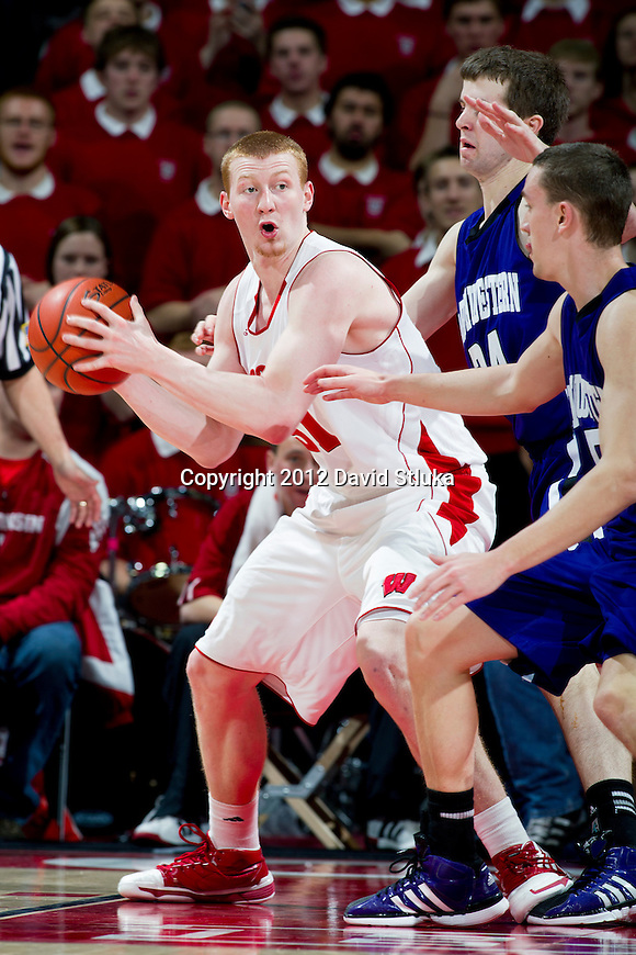 Wisconsin Badgers forward Mike Bruesewitz (31) handles the ball during a Big Ten Conference NCAA college basketball game against the Northwestern Wildcats on January 18, 2012 in Madison, Wisconsin. The Badgers won 77-57. (Photo by David Stluka)