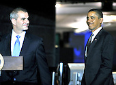 McLean, VA - October 6, 2009 -- United States President Barack Obama, right, smiles as he enters to make remarks during a visit to the National Counterterrorism Center (NCTC) in McLean, VA on Tuesday, October 6, 2009.  at left is Michael Leiter, Director, National Counterterrorism Center..Credit: Ron Sachs / Pool via CNP