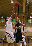 Manogue's Zachary Wurm shoots over an Alumni defender during the alumni game at the Wild West Shootout at Bishop Manogue High School in Reno, Nev., on Wednesday, Dec. 4, 2013. The Miners defeated the alumni 79-62. <br /> Photo by Cathleen Allison