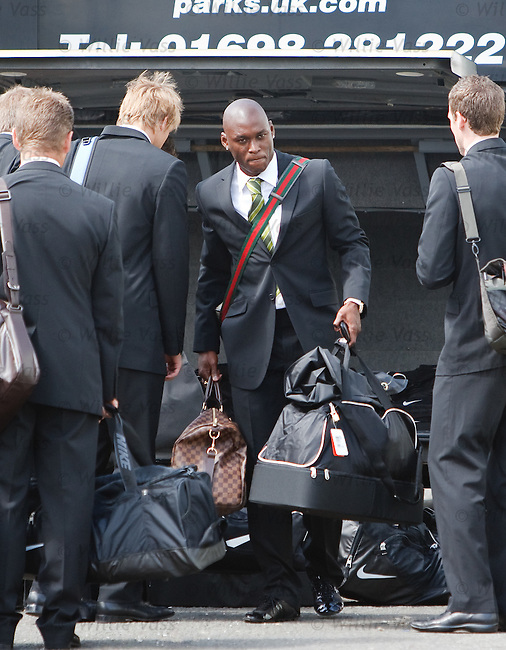 Marc-Antoine Fortune collects his luggage and sets off to Australia with Celtic