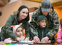 "Allie Buck and husband Bryan Buck of Wichita, Kans. help their children Hannah Buck, 5, and Travis Buck, 7, with a weaving craft Saturday, March 14, 2020, while attending the monthly storytime at the Museum of Native American History in Bentonville. Farina King, a Diné (Navajo) author an assistant professor of Native American history at Northeastern State University in Tahlequah, Okla., read 'Wisdom Weaver' by Jann A. Johnson. The children's book tells the story of a Navajo girl who learns the traditional way of making a Navajo rug from her grandmother. ""Weaving is part of who we are as a people,"" said King, whose grandmother was also a weaver. <br />