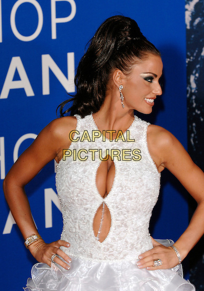 JORDAN - KATIE PRICE.World Music Awards 2006 arrrivals.Earls Court, London England,15th November 2006.half length white silver jewel encrusted cut out cleavage earrings diamonds floral embroidered print dress hands on hips profile.CAP/PL.©Phil Loftus/Capital Pictures