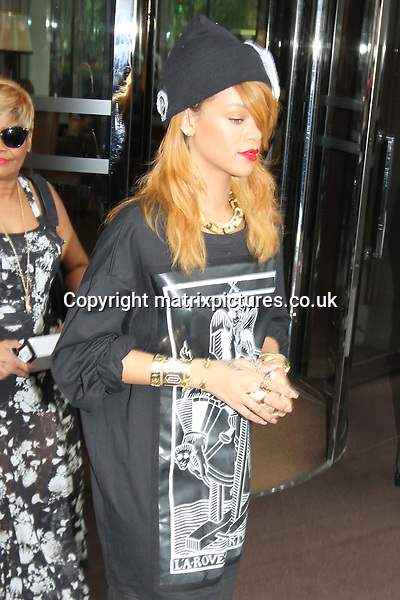 NON EXCLUSIVE PICTURE: MATRIXPICTURES.CO.UK<br /> PLEASE CREDIT ALL USES<br /> <br /> WORLD RIGHTS<br /> <br /> Barbadian- American pop star Rihanna is pictured wearing all black with golden jewellery as she leaves her hotel in Central London.<br /> <br /> JUNE 20th 2013<br /> <br /> REF: WFE 134228