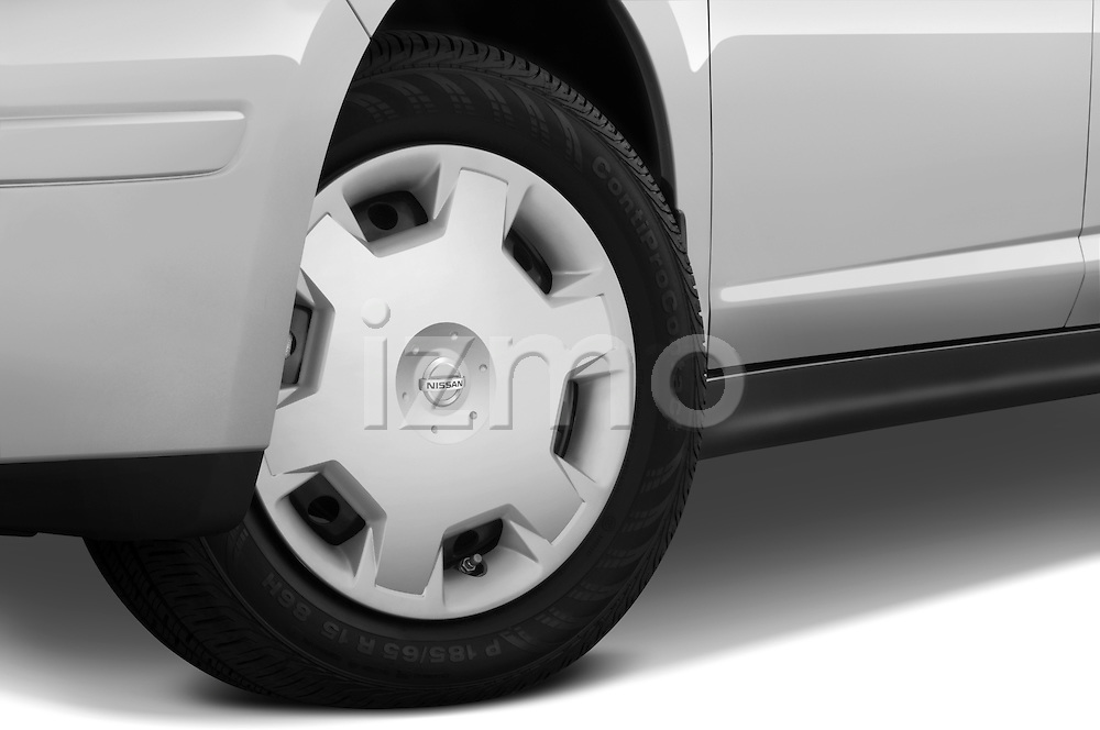 Tire and wheel close up detail view of a 2009 Nissan Versa Hatchback