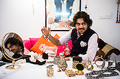 Siddharth Kasliwal of Gem Palace shows off expensive diamond jewelry office in Jaipur, Rajasthan, India. The portrait of his father, Munnu Kasliwal is seen in the background.