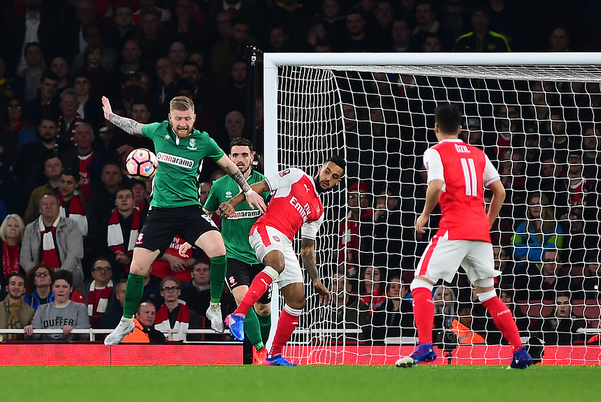 Lincoln City's Alan Power vies for possession with Arsenal's Theo Walcott<br /> <br /> Photographer Andrew Vaughan/CameraSport<br /> <br /> The Emirates FA Cup Quarter-Final - Arsenal v Lincoln City - Saturday 11th March 2017 - The Emirates - London<br />  <br /> World Copyright &copy; 2017 CameraSport. All rights reserved. 43 Linden Ave. Countesthorpe. Leicester. England. LE8 5PG - Tel: +44 (0) 116 277 4147 - admin@camerasport.com - www.camerasport.com