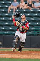 Hickory Crawdads catcher Jose Trevino (7) tracks a pop fly during the game against the Greensboro Grasshoppers at L.P. Frans Stadium on May 6, 2015 in Hickory, North Carolina.  The Crawdads defeated the Grasshoppers 1-0.  (Brian Westerholt/Four Seam Images)