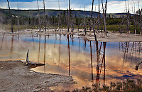 Reflections in Opalescent Pool in Black Sands Basin, Yellowstone National Park.