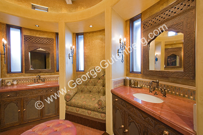 Elegant luxury bath with domed ceiling, red marble floor ,chandeleir, and built-in seating area Stock photo of master bath, en suite, bathroom