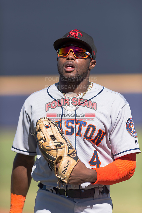Scottsdale Scorpions center fielder Ronnie Dawson (4), of the Houston Astros organization, walks off the field between innings during an Arizona Fall League game against the Peoria Javelinas at Peoria Sports Complex on October 18, 2018 in Peoria, Arizona. Scottsdale defeated Peoria 8-0. (Zachary Lucy/Four Seam Images)