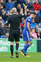 (L-R) Referee Martin Atkinson shows a yellow card to Greg Cunningham of Cardiff City during the Premier League match between Cardiff City and Brighton & Hove Albion at the Cardiff City Stadium, Cardiff, Wales, UK. Saturday 10 November 2018