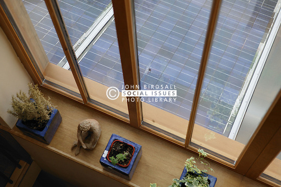 Photo Voltaic ( PV ) Solar Panels on conservatory roof of Eco House at The Wintles; Bishop's Castle,