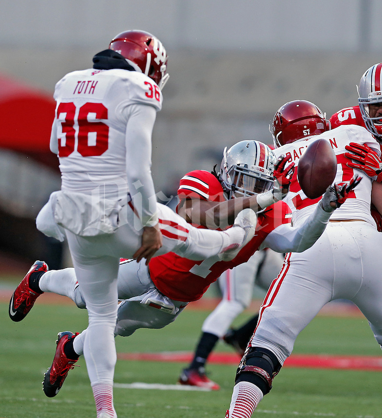 Ohio State Buckeyes cornerback Bradley Roby (1) blocks the punt of Indiana Hoosiers punter Erich Toth (36) during the second quarter of their College football game at Ohio Stadium in Columbus, Ohio on November 23, 2013.  (Dispatch photo by Kyle Robertson)
