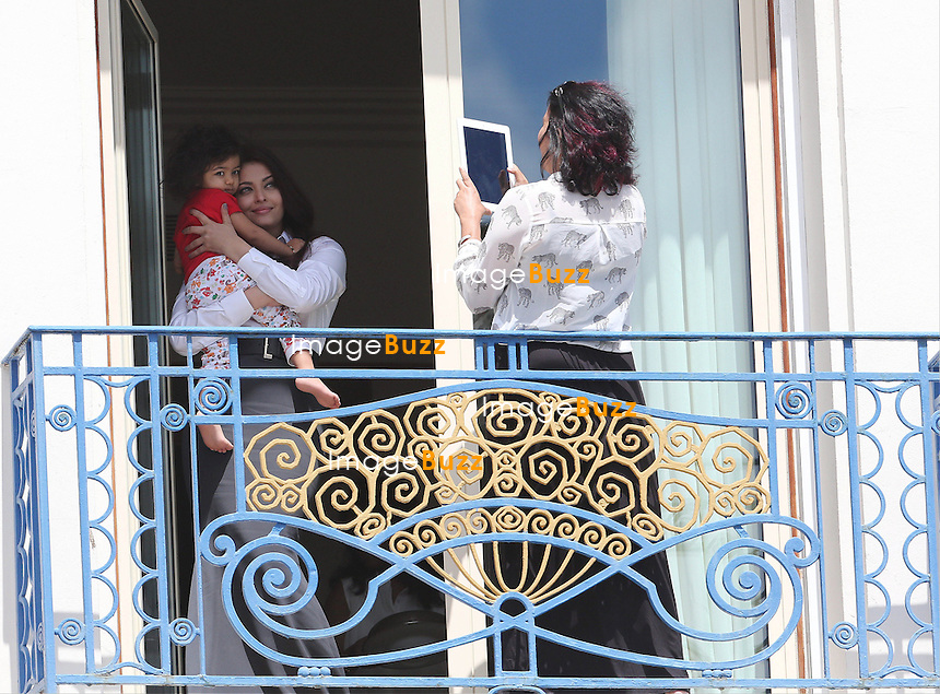 AISHWARYA RAI & DAUGHTER - May 19, 2013-Cannes (FR)-Aishwarya Rai and daughter Aaradhya sighting on the balcony at the Martinez Hotel during the 66th Cannes Film Festival.
