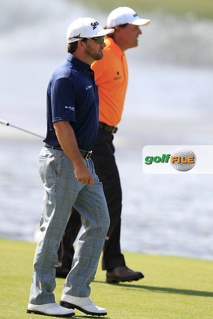 Graeme McDowell (NIR) and Phil Mickelson (USA) during the 1st round at the WGC Cadillac Championship, Blue Monster, Trump National Doral, Doral, Florida, USA<br /> Picture: Fran Caffrey / Golffile