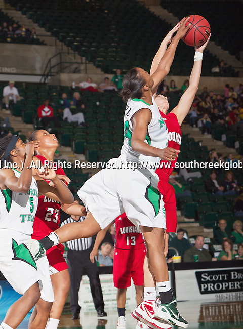 North Texas Mean Green forward Jasmine Godbolt (24) in action during the game between the Louisiana Lafayette Ragin' Cajuns and the University of North Texas Mean Green at the North Texas Coliseum,the Super Pit, in Denton, Texas. UNT defeats Louisiana Lafayette 78 to 40....