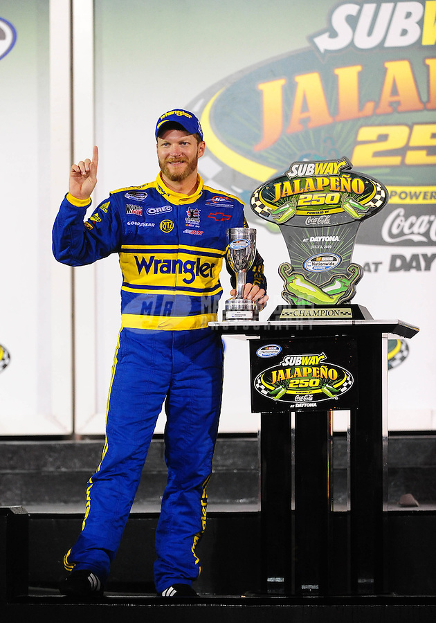 Jul. 2, 2010; Daytona Beach, FL, USA; NASCAR Nationwide Series driver Dale Earnhardt Jr celebrates in victory lane after winning the Subway Jalapeno 250 at Daytona International Speedway. Mandatory Credit: Mark J. Rebilas-
