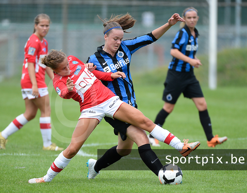 20140802 - VARSENARE , BELGIUM : Club Brugge's Tine De Caigny (r) pictured in a duel with Kongsvinger's Nora Hanssen (l) during the friendly soccer match between the women teams of Belgian Bene League team of  Club Brugge Vrouwen  and Norwegian Kongsvinger  , on Saturday 2nd August 2014 in Varsenare .  PHOTO DAVID CATRY